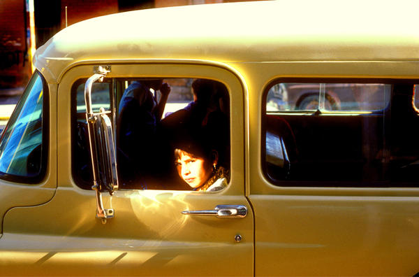 Wary girl in a GMC truck, downtown El Paso, 1980