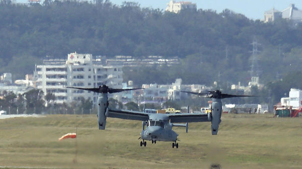 An Osprey arrives at U.S. Marine Corps Air Station Futenma in Ginowan city on Japan's southern island of Okinawa on Monday. Six Ospreys were deployed in Okinawa, drawing sharp reactions from residents amid persistent concerns about the aircraft's safety.