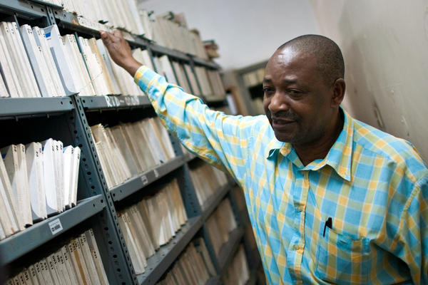 Radio Tanzania archivist Bruno Nanguka stands with just a few of the 15,000 reel-to-reel tapes stored in the station's archives.