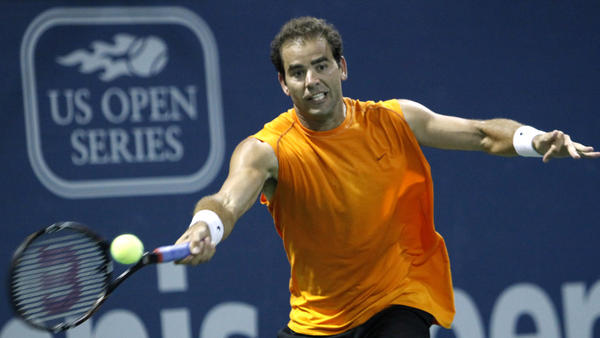 Pete Sampras returns a forehand against Russia's Marat Safin during an exhibition tennis match at the L.A. Tennis Open tournament in 2009. The tournament, which has been around for decades, is now relocating to Colombia as America's dominance in the sport declines and global appeal surges.