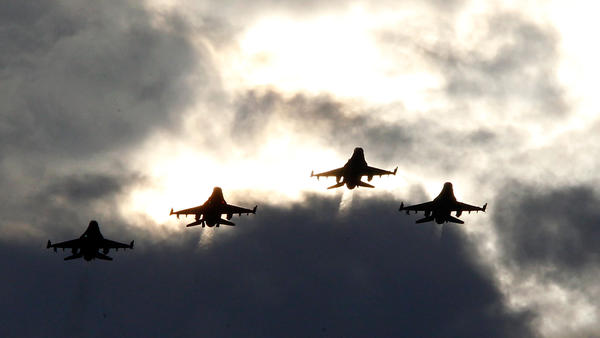Four F-16s from the 77th Fighter Squadron of Shaw Air Force Base fly over Darlington Raceway before a NASCAR race in Darlington, S.C., in May 2012.