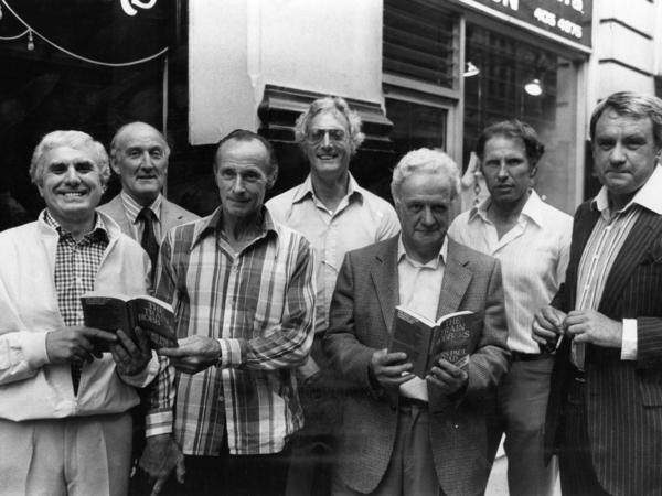The Great Train Robbers (from left): Buster Edwards, Tom Wisbey, Jim White, Bruce Reynolds, Roger Cordrey, Charlie Wilson and Jim Hussey, with copies of their book <em>The Train Robbers</em> in 1979.