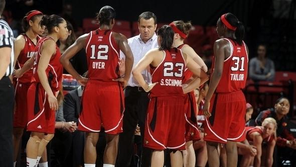 Head coach Jeff Walz of the Louisville Cardinals talks to his team during a timeout in the game against the Maryland Terrapins in the second round of the NCAA women's basketball tournament.