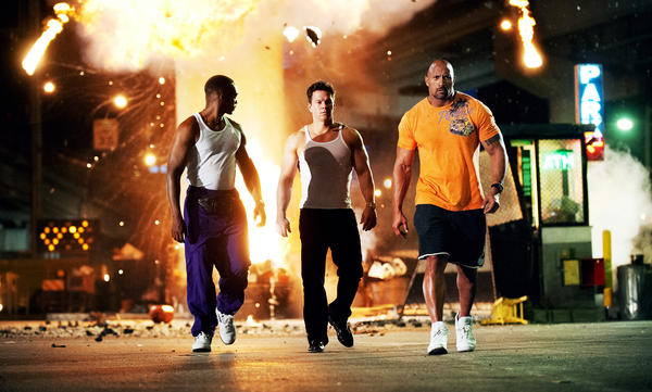 <strong>The Bang-Bang Club:</strong> <em>Pain & Gain,</em> with Anthony Mackie, Mark Wahlberg and Dwayne Johnson as three guys on a heist, is a coulda-been-nimble caper that got Michael Bay-ified on the way to the multiplex.