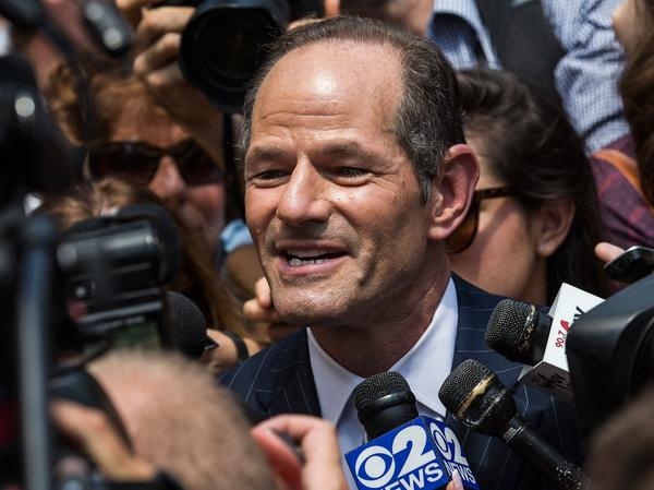 Reporters swarm around former New York Gov. Eliot Spitzer as he attempts to collect signatures for his run for New York City comptroller.