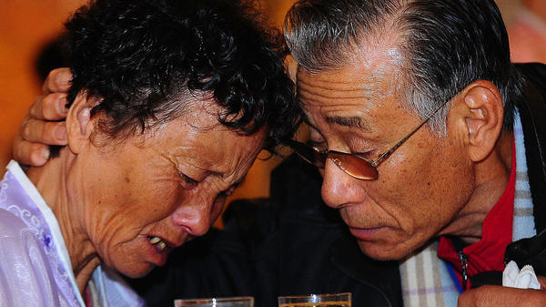 South Korean Kim Jung-Man, right, bids farewell to his North Korean relative before they return to their respective homes on opposite sides of the border in November 2010.