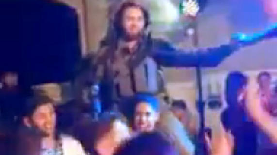"An image taken from an amateur video shows an Israeli soldier dancing atop a Palestinian man's shoulders to the song ""Gangnam Style."" The soldier and his colleagues have been suspended."
