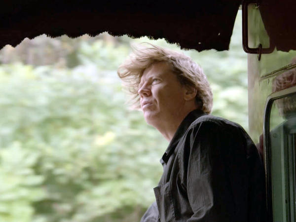 Sonic Youth's Thurston Moore gazes over the rail on the Station to Station train as it speeds across the country.