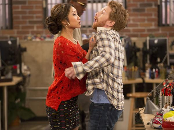 Brenda Song and Seth Green in Fox's <em>Dads</em>.