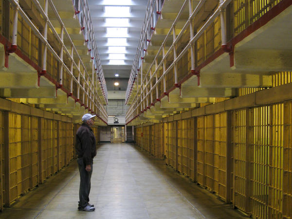 Bill Baker stares up at the rows of empty cells during his visit to the prison.