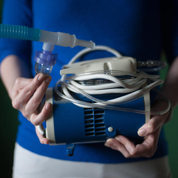 Virginia Rady, 28, holds her old nebulizer at her home in Dallas. Rady was diagnosed with chronic persistent asthma at age 2. She underwent a series of three outpatient surgeries between December 2012 and February 2013 for a procedure known as bronchial thermoplasty. She says the procedure has changed her life, allowing her to remove her nebulizer from her bedside.