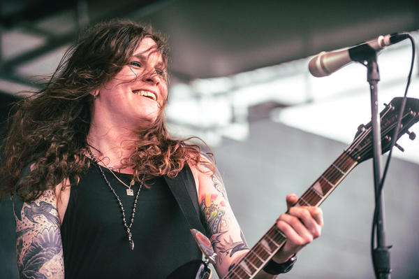 Against Me!'s Laura Jane Grace breaks into a smile during her band's set at the Spin day party at Stubb's.