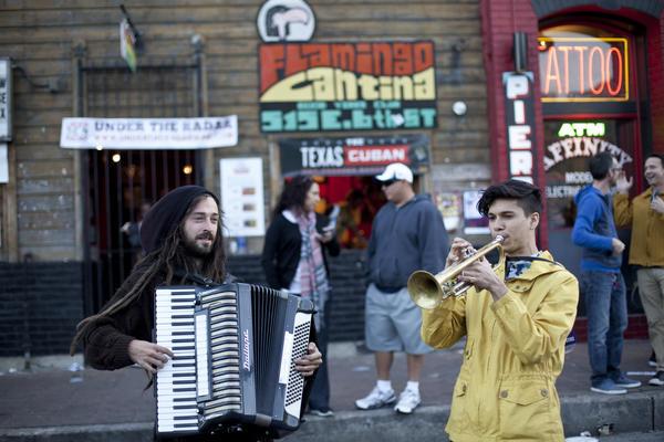 Cleancut trumpeter, meet dreadlocked accordionist.