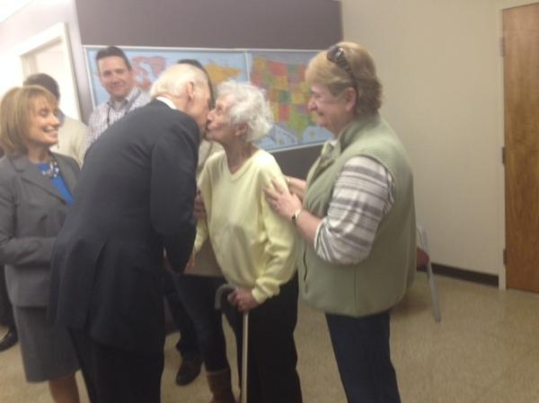 Vice President Biden greets Enis Sullivan, 101, with a kiss Tuesday in New Hampshire.