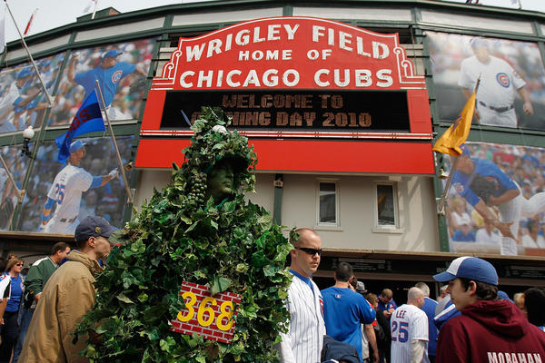 A fan dressed as the outfield ivy wall walks in front of Wrigley Field before an Opening Day game between the Cubs and the Milwaukee Brewers in 2010.