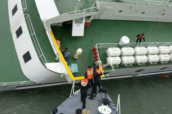 Passengers are taken to safety by South Korea's coast guard.
