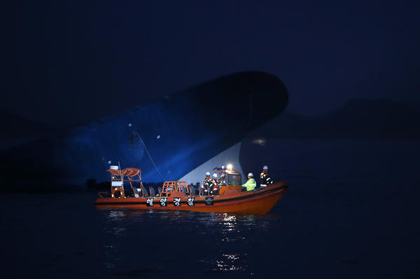 Maritime police search for passengers. Hours after the ferry capsized, close to 300 people were still missing off the southern coast of South Korea.