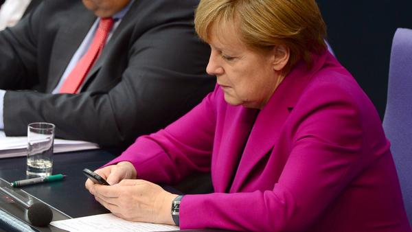 German Chancellor Angela Merkel at a session of the Bundestag Lower House of Parliament in Berlin Wednesday. Germany's top federal prosecutor told legislators today that he is opening a formal inquiry into allegations that the NSA tapped her phone.