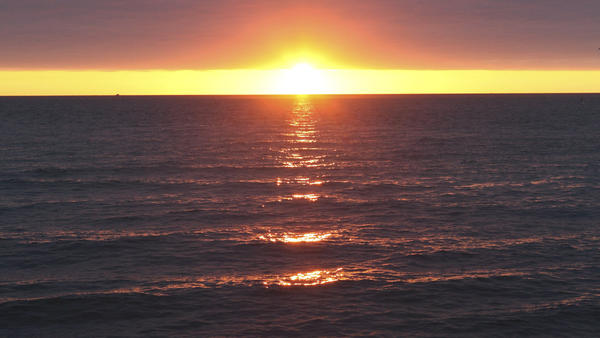 The Department of the Interior is proposing a large expansion of U.S. efforts to make energy from offshore winds, with a plan centered off the Massachusetts coast. Here, a 2010 photo shows a sunrise over Nantucket Sound.