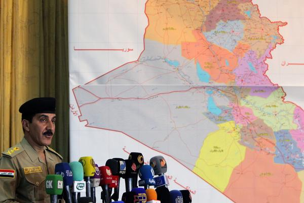 The Iraqi prime minister's security spokesman, Lt. Gen. Qassem Atta, holds a press conference on Saturday in Baghdad. The government is launching an offensive against insurgents in the northern city of Tikrit.