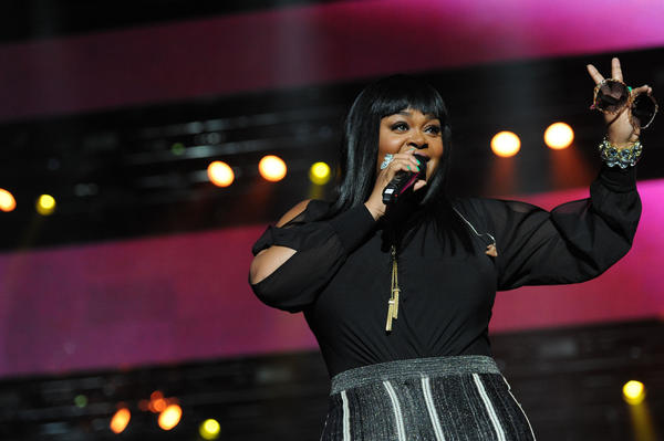 "Jill Scott, on the main stage at the 2014 Essence Festival, thanked the crowd for ""letting a sister grow."""