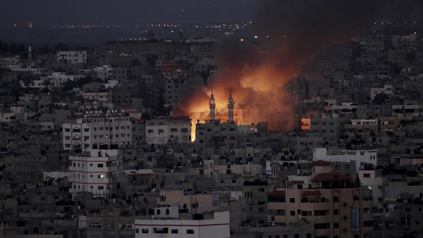 Smoke and flames from an Israeli strike rise over Gaza City on Thursday.