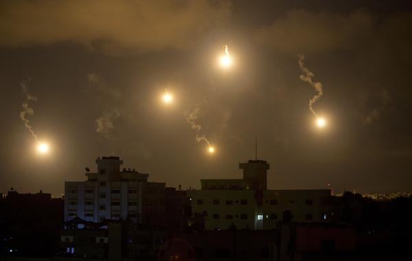 Israeli army flares illuminate the sky above the Gaza Strip on July 18. After waging an air campaign initially, Israel has sent ground troops into the territory.