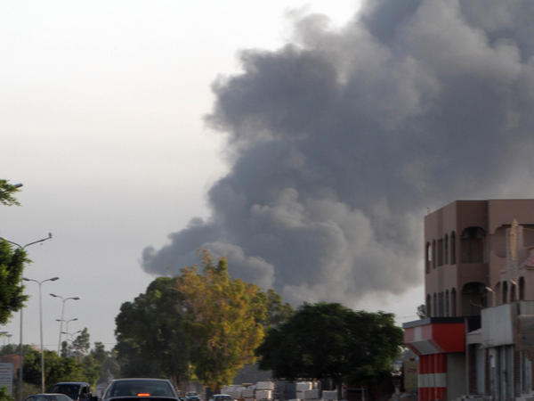 In a photo taken on Thursday, smoke rises from a residential area in Tripoli, Libya. Deadly clashes erupted between Islamist fighters and pro-secular militias earlier this month.