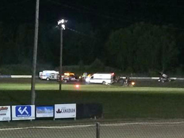 Ambulances converge Aug. 9 on the racetrack at Canandaigua Motorsports Park in upstate New York, where sprint car racer Kevin Ward Jr. was hit and killed by Tony Stewart.