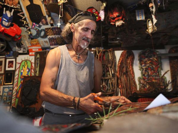 """Mathias """"Spider"""" Schergen at work in his home art studio."""