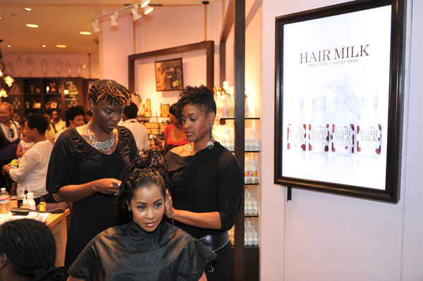 "<em>Real Housewives of Atlanta</em> star Lisa Wu Hartwell gets a hair treatment at a ""Curl Party"" hosted by Carol's Daughter and theYBF.com in 2010."