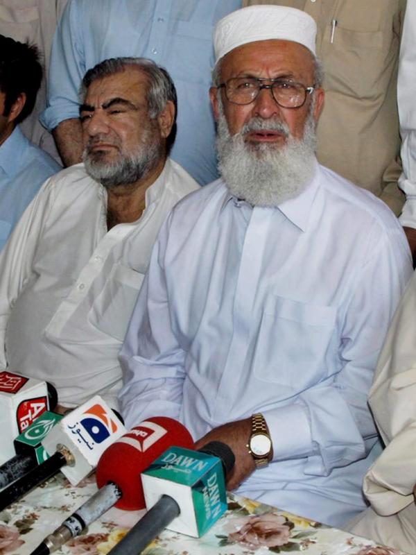 Ajmal Khan, vice chancellor of Islamia College University, talks with journalists after his release from Taliban captivity in August.