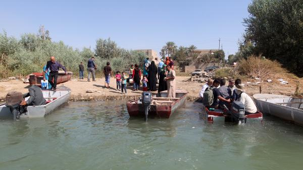 Citizens of Dhuluiyah, Iraq, must take boats to get in an out, since one of the town's two bridges was blown up by the Islamic State and the other was commandeered by tribesmen defending them.