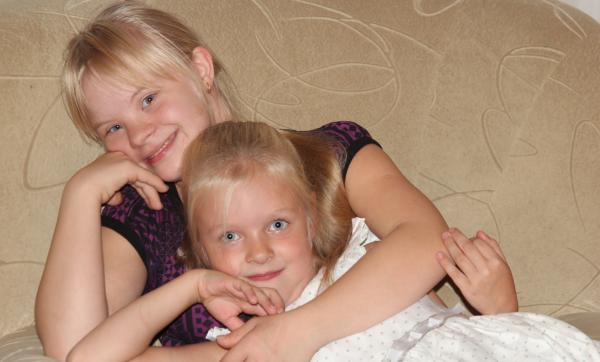 Dasha Daunis, (back) a 15-year-old with Down syndrome, is shown with her sister, Anna, 7. When Dasha was born, Russian health officials urged the family to put her in an orphanage. But after a year, Dasha's family took her back. Throughout Russia, nearly 30 percent of children with disabilities are placed in state orphanages.