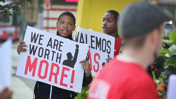 Fast-food workers and activists demonstrate outside a Chicago McDonald's in July in favor of a higher minimum wage. Illinois voters on Tuesday called on the state Legislature to approve a $10 minimum wage.