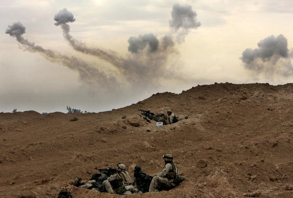 U.S. Marines take position on the outskirts of Fallujah, Iraq, at the start of a major operation to combat insurgents in the city, on Nov. 8, 2004.