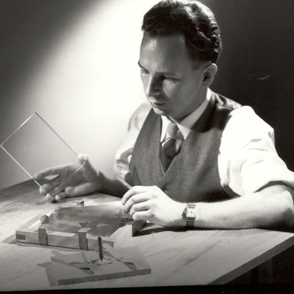 S. Donald Stookey, photographed in 1950, prepares to expose an image to ultraviolet light. Stookey forever changed cooking with the invention of CorningWare.