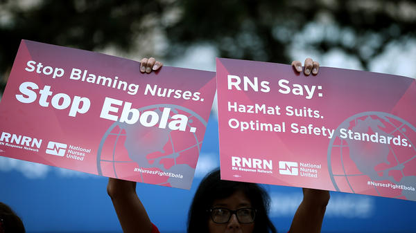 A nurse at the University of California Medical Center in San Francisco protests lack of Ebola preparedness in October. The issue will be the focus of national demonstrations Wednesday.