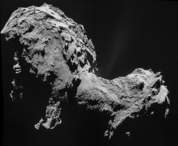 Researchers had thought comet 67P was shaped like a lumpy potato. But as they drew closer, they realized it was far stranger. This image was taken on Sept. 19 at a distance of around 18 miles from the comet.