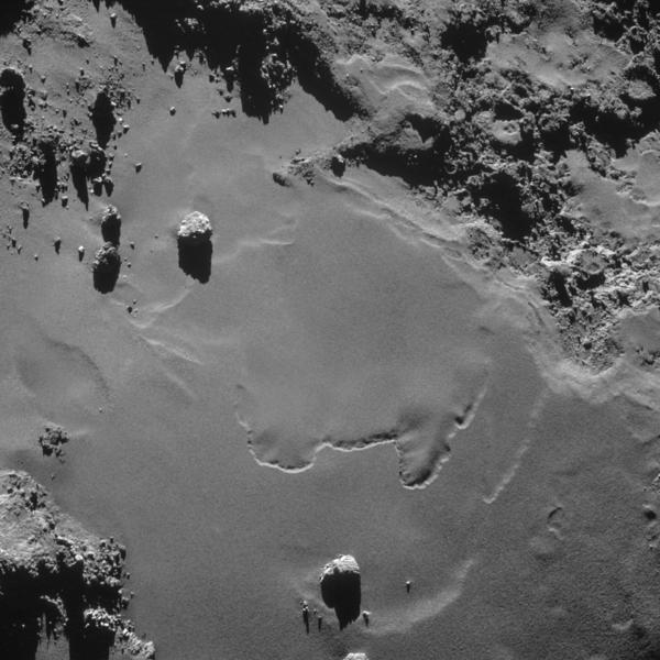 Boulders are strewn across even the flattest areas of the comet. The largest ones in this picture are the size of buildings.