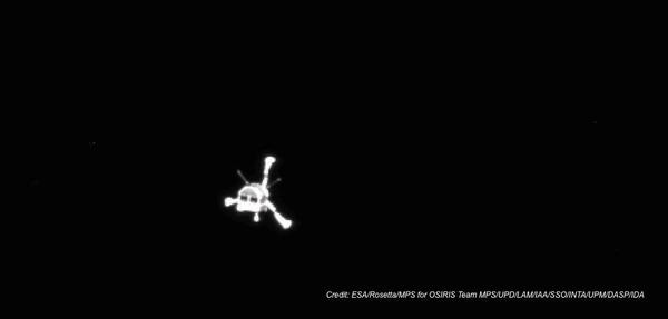 The Philae lander is seen from the view of its parent spacecraft as it heads toward a first-of-its-kind rendezvous with a comet.