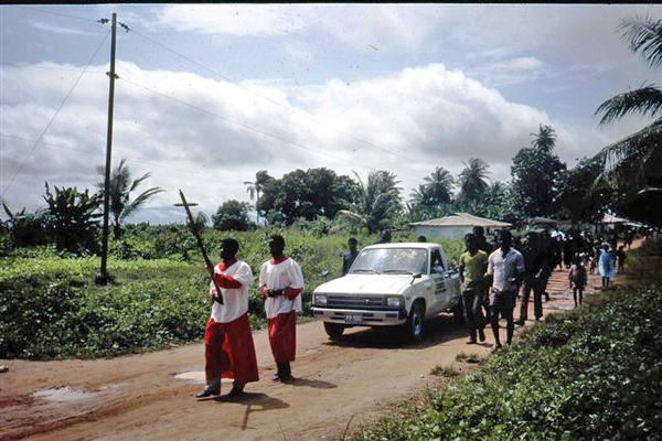 Church leaders take part in a funeral procession.