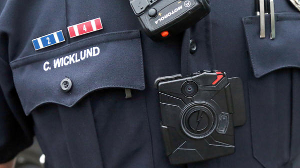 Few police departments have required officers to wear body cameras, but that's changing after the events in Ferguson, Mo., this summer.