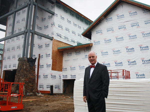 Atlantic City Mayor Don Guardian stands in front of an outdoor goods store under construction. The state's Casino Reinvestment Development Authority contributed land and $12 million for the project.