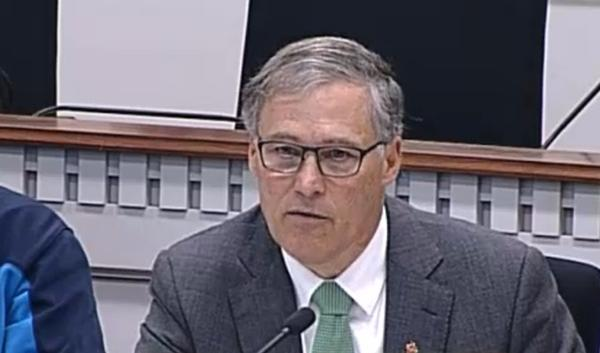 A file photo of Washington Gov. Jay Inslee at the Capitol in 2013, calling for state action to curb the emission of greenhouse gasses that contribute to global climate change.