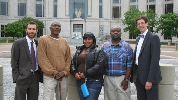 Sharnalle Mitchell (center) in Montgomery in May, after winning an injunction to stop the city from collecting court fines. With her (from left): attorney Alec Karakatsanis, fellow plaintiffs Lorenzo Brown and Tito Williams and attorney Matt Swerdlin.