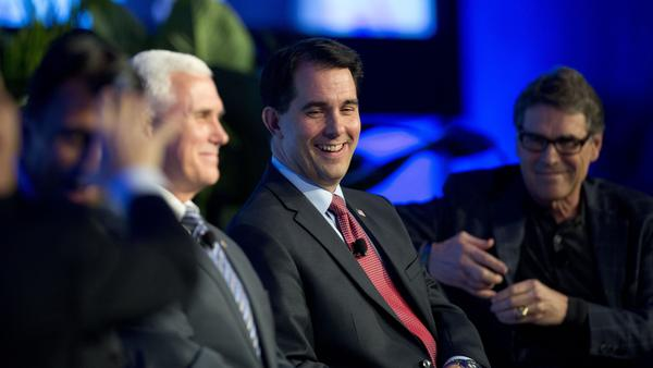 Wisconsin Gov. Scott Walker (center) talks about recent Republican Party gains and the road ahead for the GOP as Indiana Gov. Mike Pence (left) and Texas Gov. Rick Perry listen during a Wednesday press conference at the Republican governors' conference in Boca Raton, Fla.