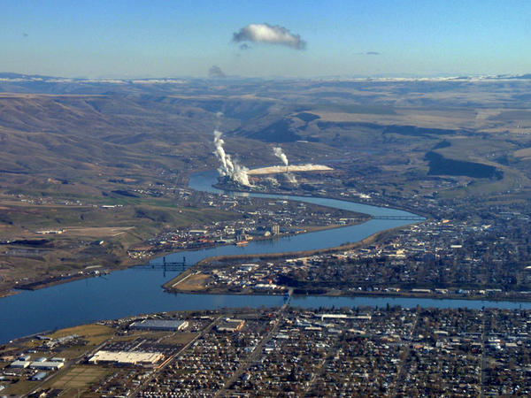 Lewiston's port hugs the left bank of this aerial view of the confluence of the Snake and Clearwater Rivers. Clarkston is at lower right.
