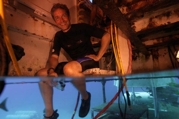 Fabien Cousteau sits inside Aquarius Reef Base in 2012. If he is able to remain under water for 31 days, he will have lasted one day longer than his grandfather, Jacques Cousteau.