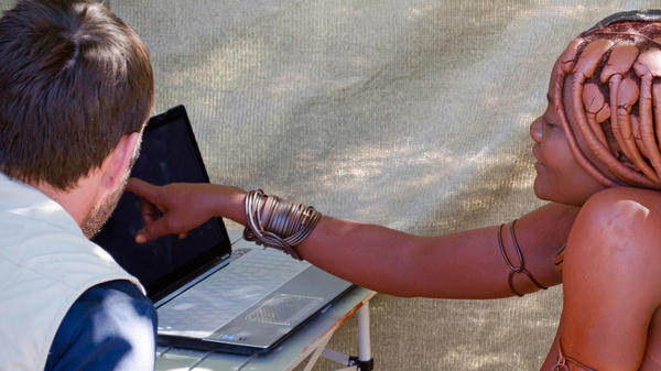 A woman from the Twe tribe tests her ability to mentally rotate an item on a laptop computer. In the battle of the sexes, researchers in the Namibia study found men to be the better mental rotaters.